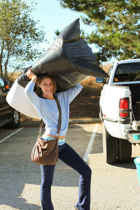 Striking a pose while moving in with a mattress pad.