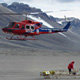 helicopter and scientist on ground