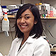 Laura Jimenez in lab coat with pipette