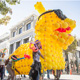 UC Santa Cruz alumni paraded with a 12-foot Sammy the Slug balloon sculpture