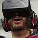 man wearing VR headset, expressing surprise