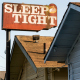 sleep tight motel sign