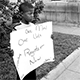 Samual Newhall, 8, demonstrating all alone in front of the Dallas County Courthouse in Sel