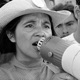 Archival photo of Dolores Huerta with a bullhorn