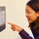 Photo of Leila Takayama interacting with a robot