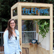 UC Santa Cruz alumna Morgan Brown with her phone booth in the Humanities Courtyard