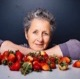 Portrait of Julie Guthman with strawberries