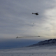 Helicopter flying instrument over snow
