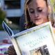 girl reading Dickens' A Christmas Carol