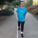 Karen Arcos walking with a cane