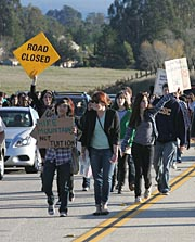 Protesters march up Empire Grade