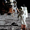 Astronaut Buzz Aldrin setting up a reflective device on the moon