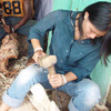 Chai Chang practices wood carving in Ghana
