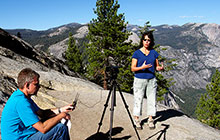 susan schwartz and david osleger recording lectures on top of a mountain in Yosemite